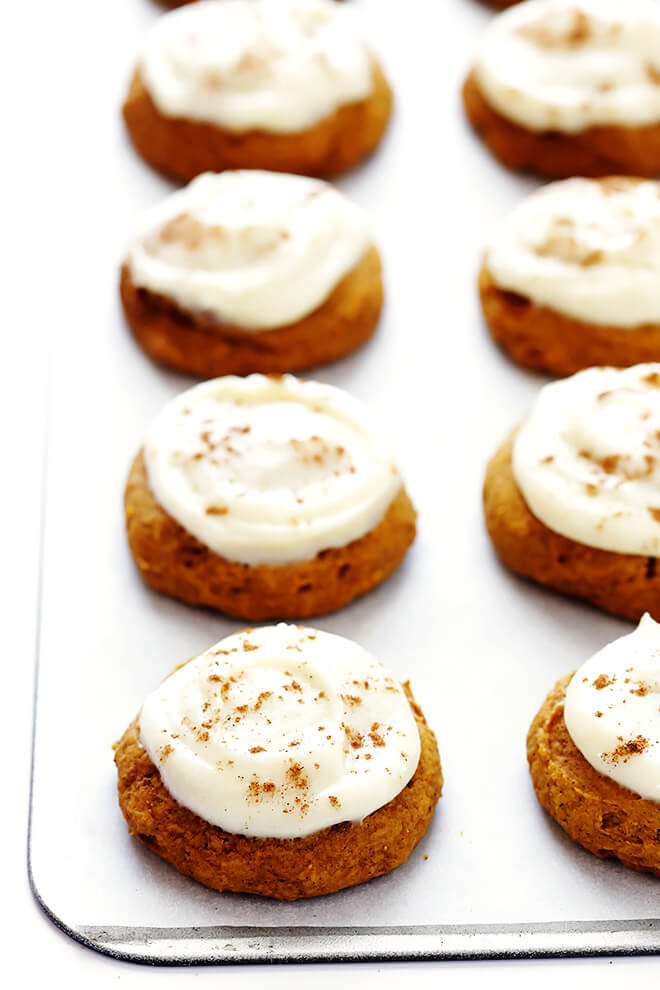 LOVE this Pumpkin Cookies recipe! They're topped with cream cheese frosting and cinnamon, made with soft and perfectly spiced cookies, and so delicious. Perfect for fall and Thanksgiving!