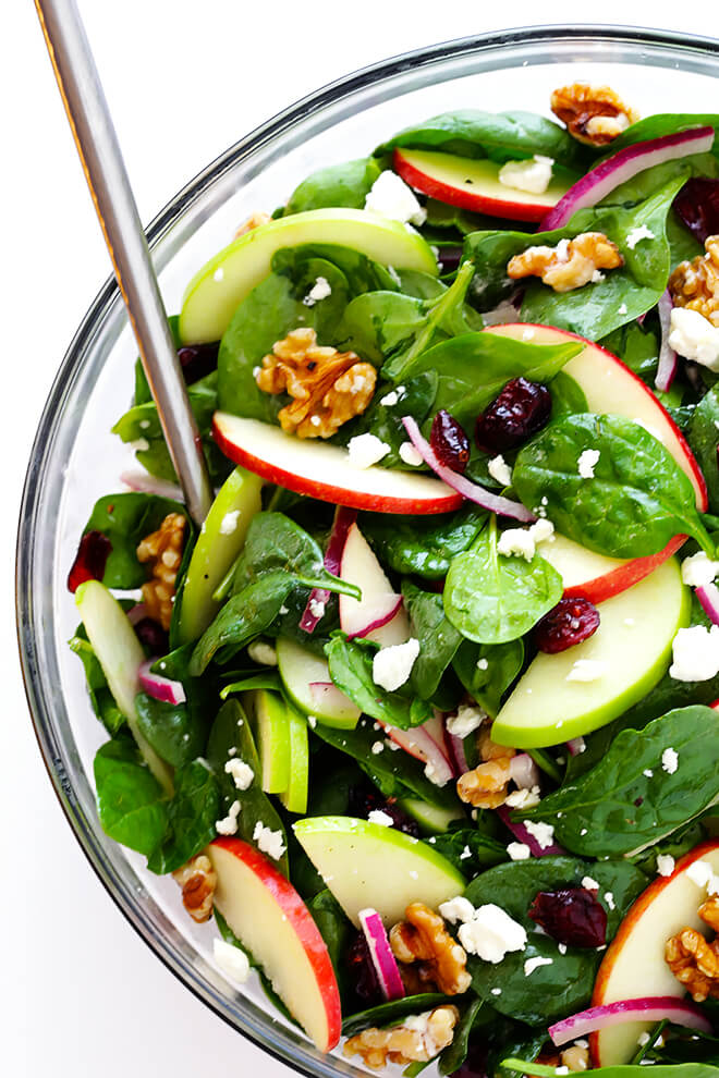 My favorite Spinach Apple Salad recipe is made with fresh apples, cranberries, goat (or blue or feta) cheese, and topped with a delicious apple cider vinaigrette.  It's the perfect salad for Fall!