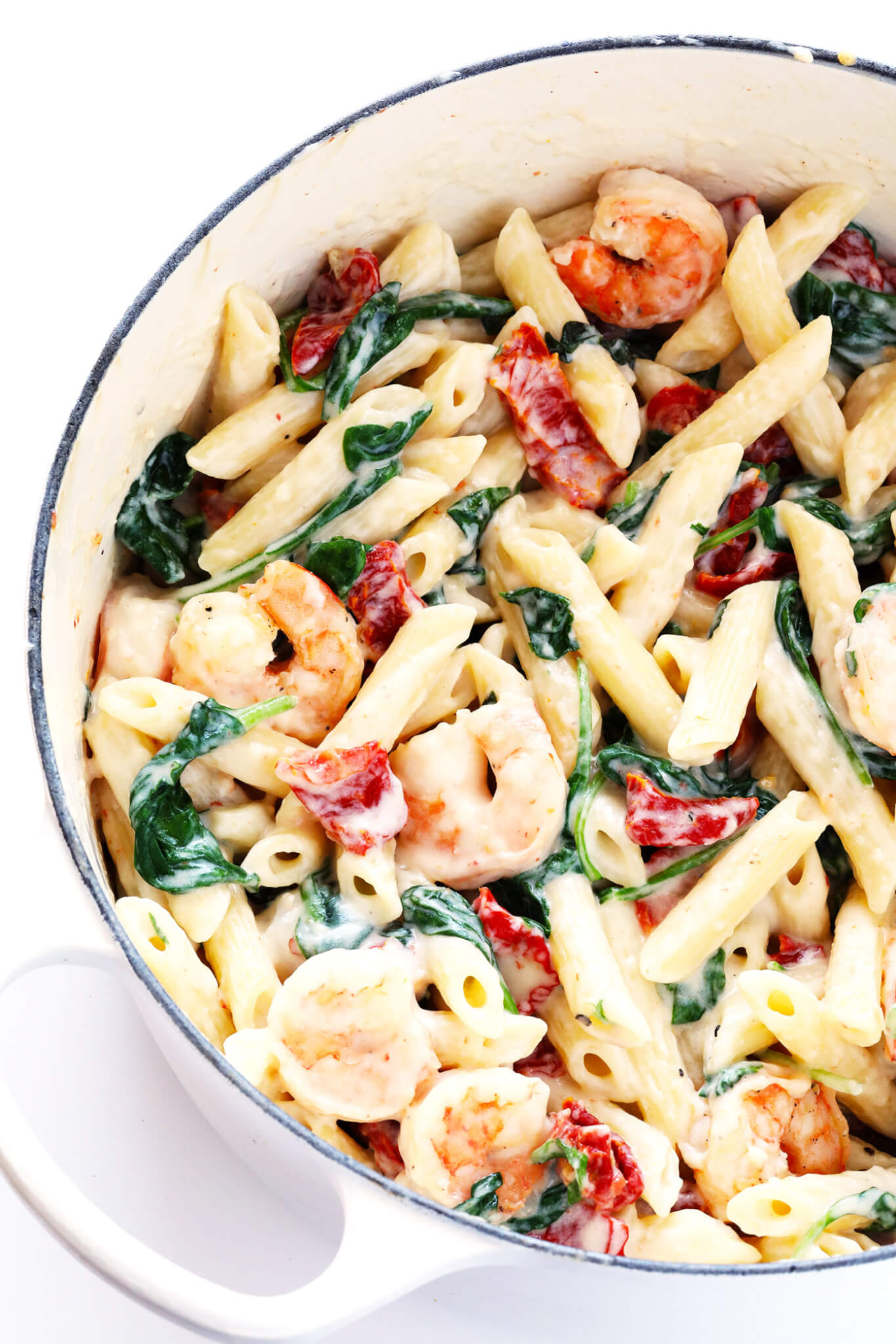 Love, love, love this Creamy Shrimp Florentine Pasta. It's easy to make, and tossed with the most delicious garlic cream sauce. My kind of dinner!   gimmesomeoven.com
