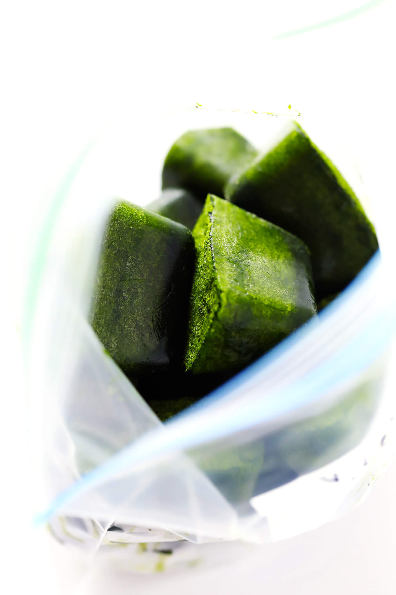 This Frozen Spinach Cubes recipe is a lifesaver! Just puree some spinach and coconut water, freeze, and add to green smoothies whenever you'd like! | gimmesomeoven.com