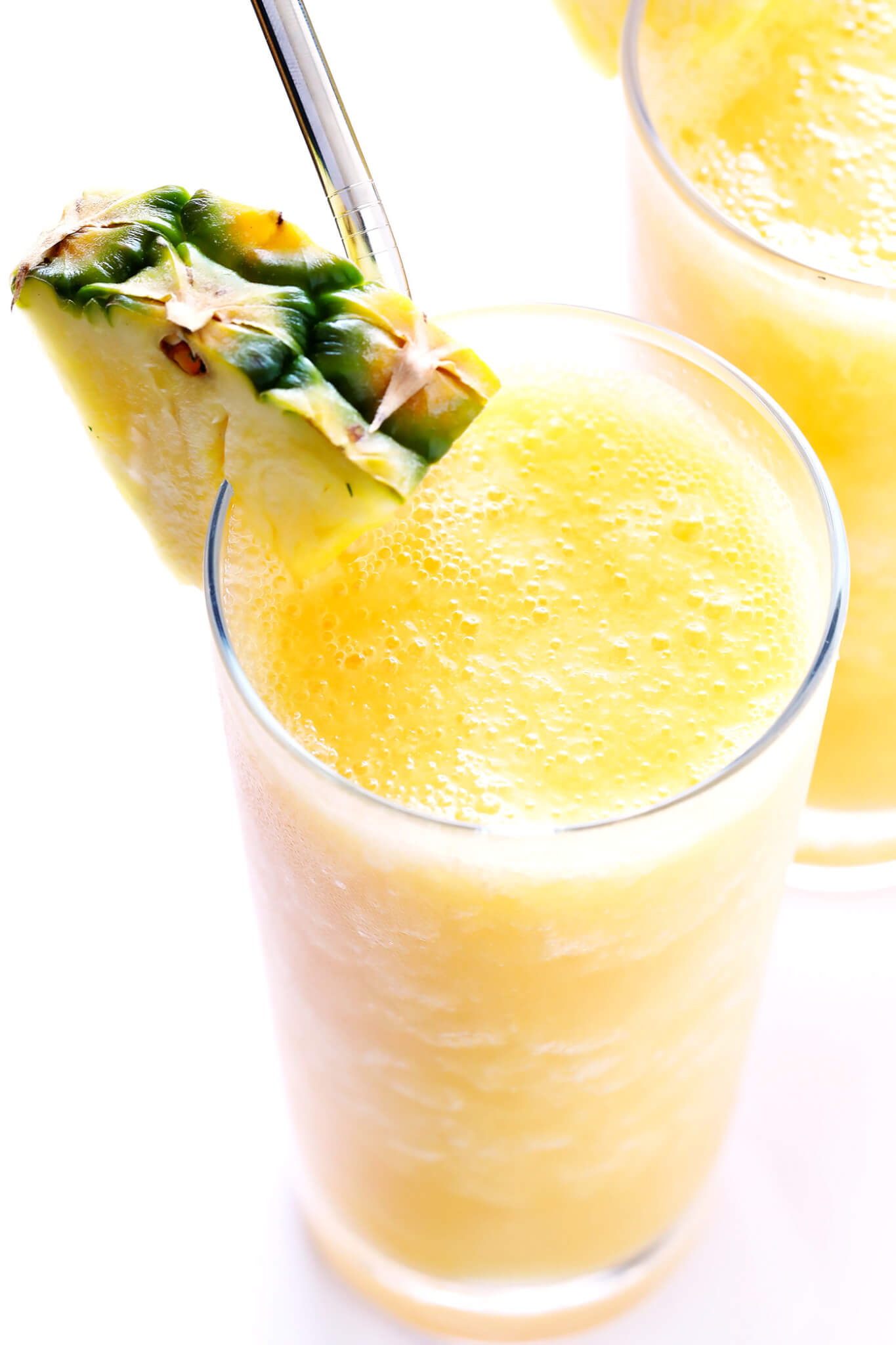 This Tropical Wine Slushies recipe is AMAZING! It's super easy to make with whatever frozen fruit you have on hand and white wine, and it's the perfect blended frozen summer cocktail!   gimmesomeoven.com