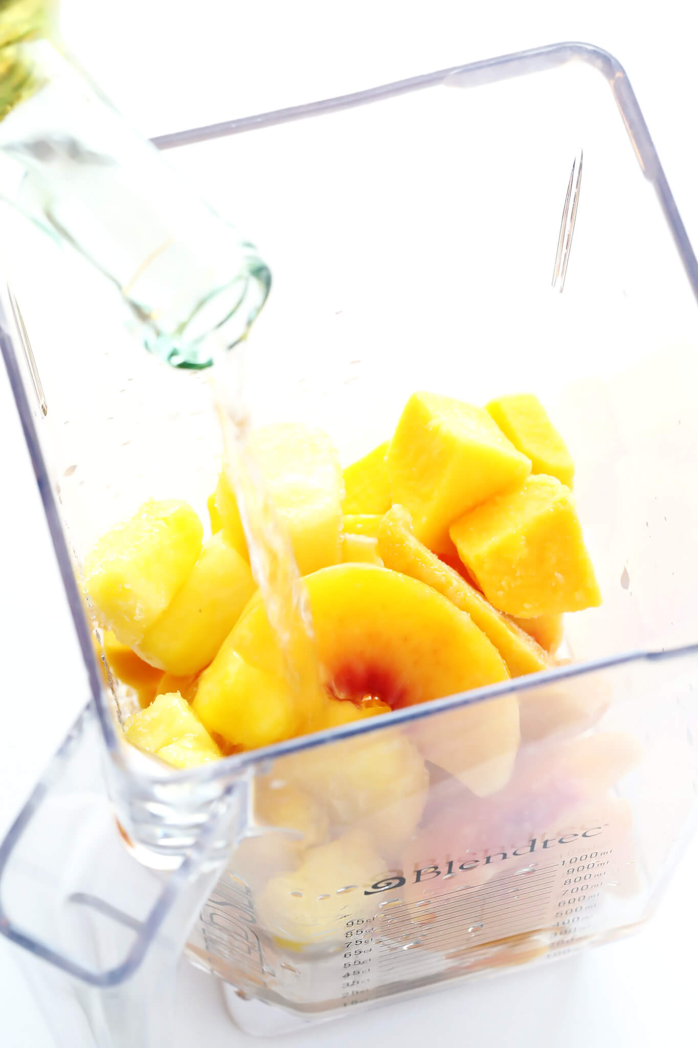 All you need is frozen fruit, white wine, and maybe a splash of orange liqueur to make these easy Tropical Wine Slushies. So fresh and delicious and perfect for frozen summer cocktail season!   gimmesomeoven.com