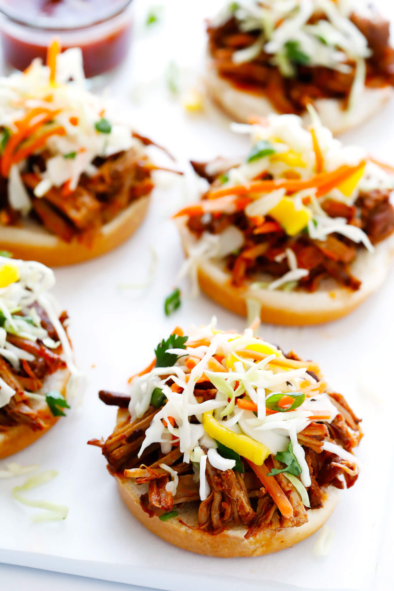 This Instant Pot Pulled Pork recipe is easy to make with your favorite BBQ sauce, and SO tender and delicious! Perfect for picnics, potlucks, or any time you're craving some delicious BBQ for dinner.   gimmesomeoven.com