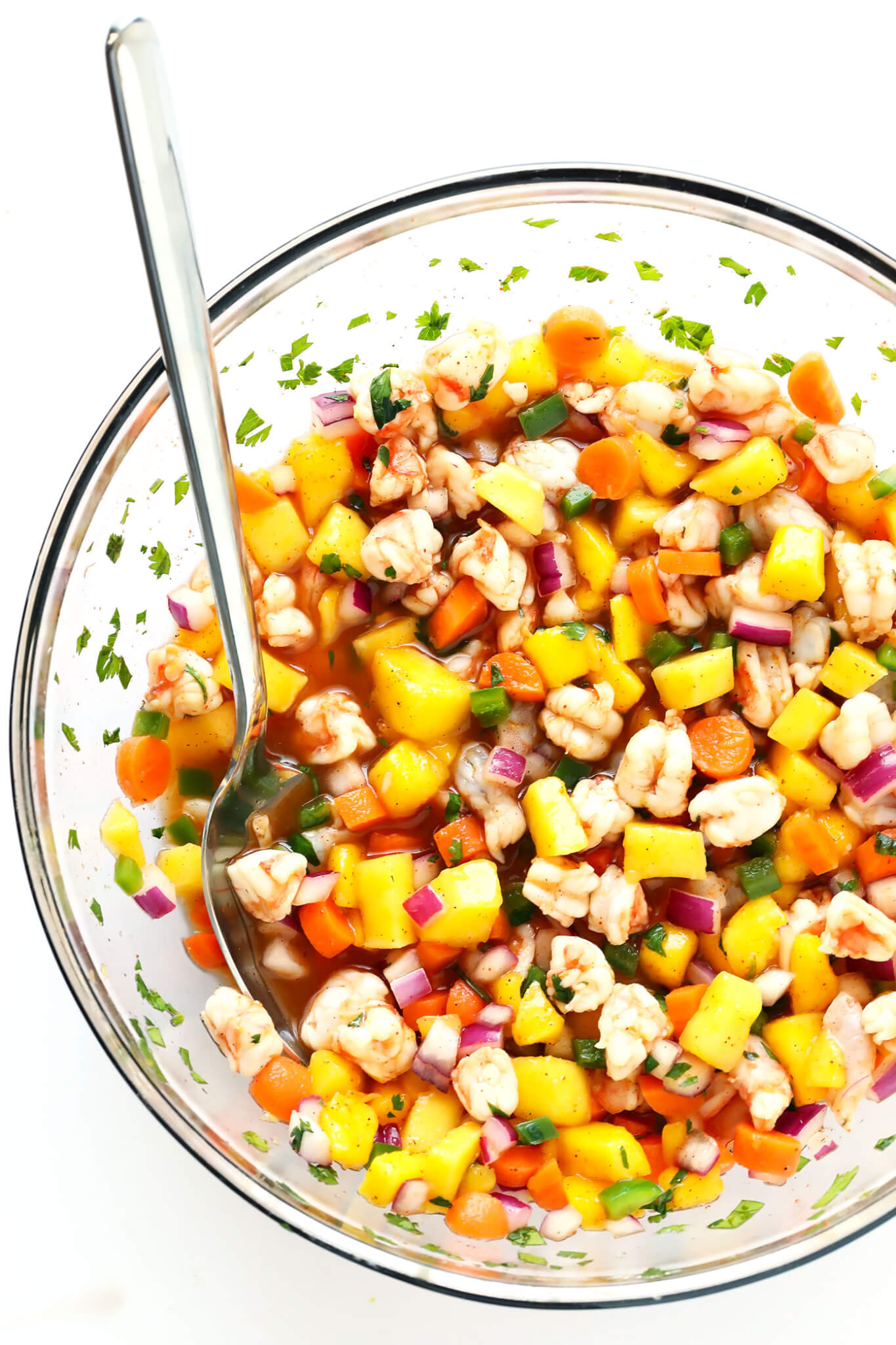 This Easy Shrimp Ceviche is made with mango, carrots, jalapeno, red onion, cilantro, and a delicious chili-lime sauce. Quick and easy to prepare, and so delicious with chips or o a tostada!   gimmesomeoven.com