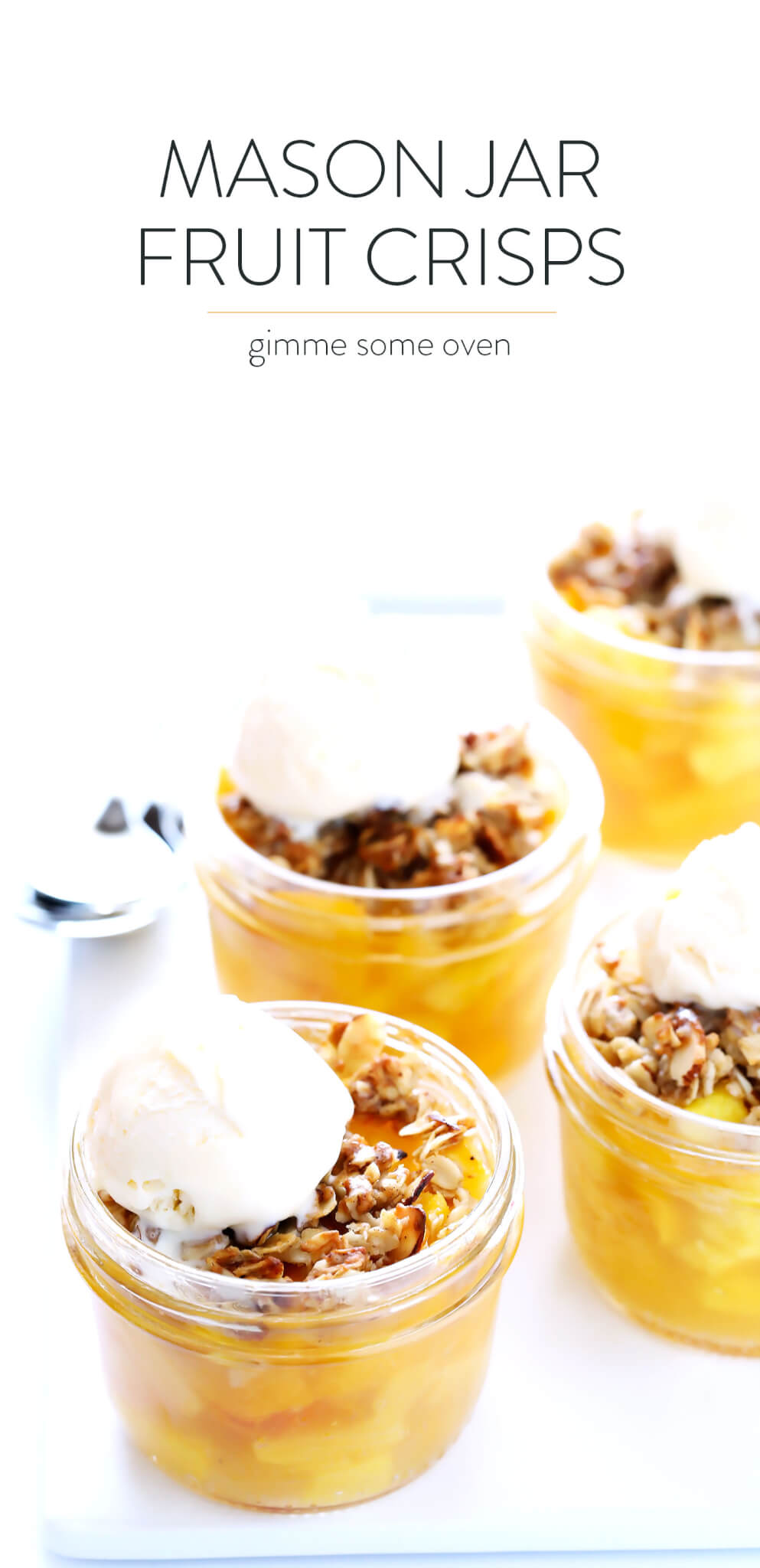 These Mini Mason Jar Fruit Crisps are easy to make with your favorite fruit (peaches, berries, apples, pears, pineapple, you pick!), they're topped with a delicious oatmeal-almond crumble, and they are SO tasty! The perfect sweet and simple summer dessert recipe! | gimmesomeoven.com