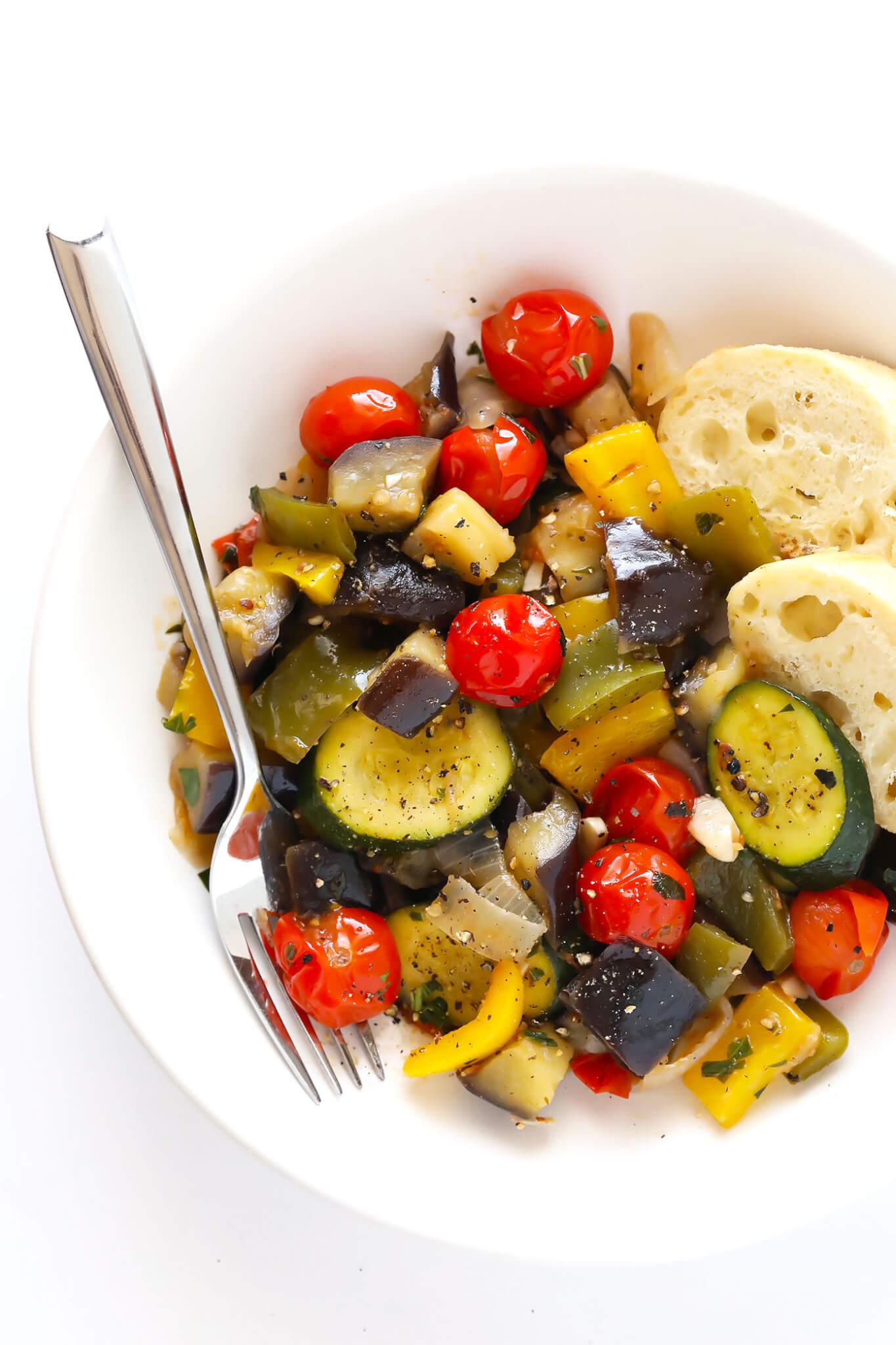 This ultra-easy Ratatouille recipe is the perfect way to use up summer vegetables (zucchini, eggplant, tomato, bell peppers, you name it!), and tastes absolutely delicious when served with crusty French bread (or pasta or quinoa or rice). An awesome healthy dinner idea, and one that's easy to customize with your favorite ingredients. | gimmesomeoven.com (Gluten-Free / Vegetarian / Vegan)