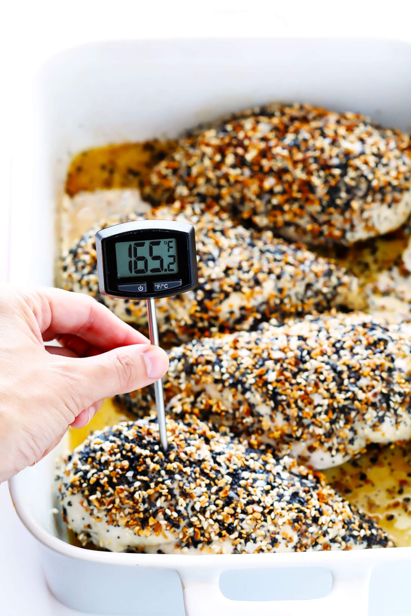"""This """"Everything"""" Chicken recipe is made with yummy everything bagel seasoning, and baked in the oven to juicy, tender, delicious perfection. It's an easy and gluten-free dinner idea that everyone will love, especially with those garlic, poppyseed, sesame flavors! 