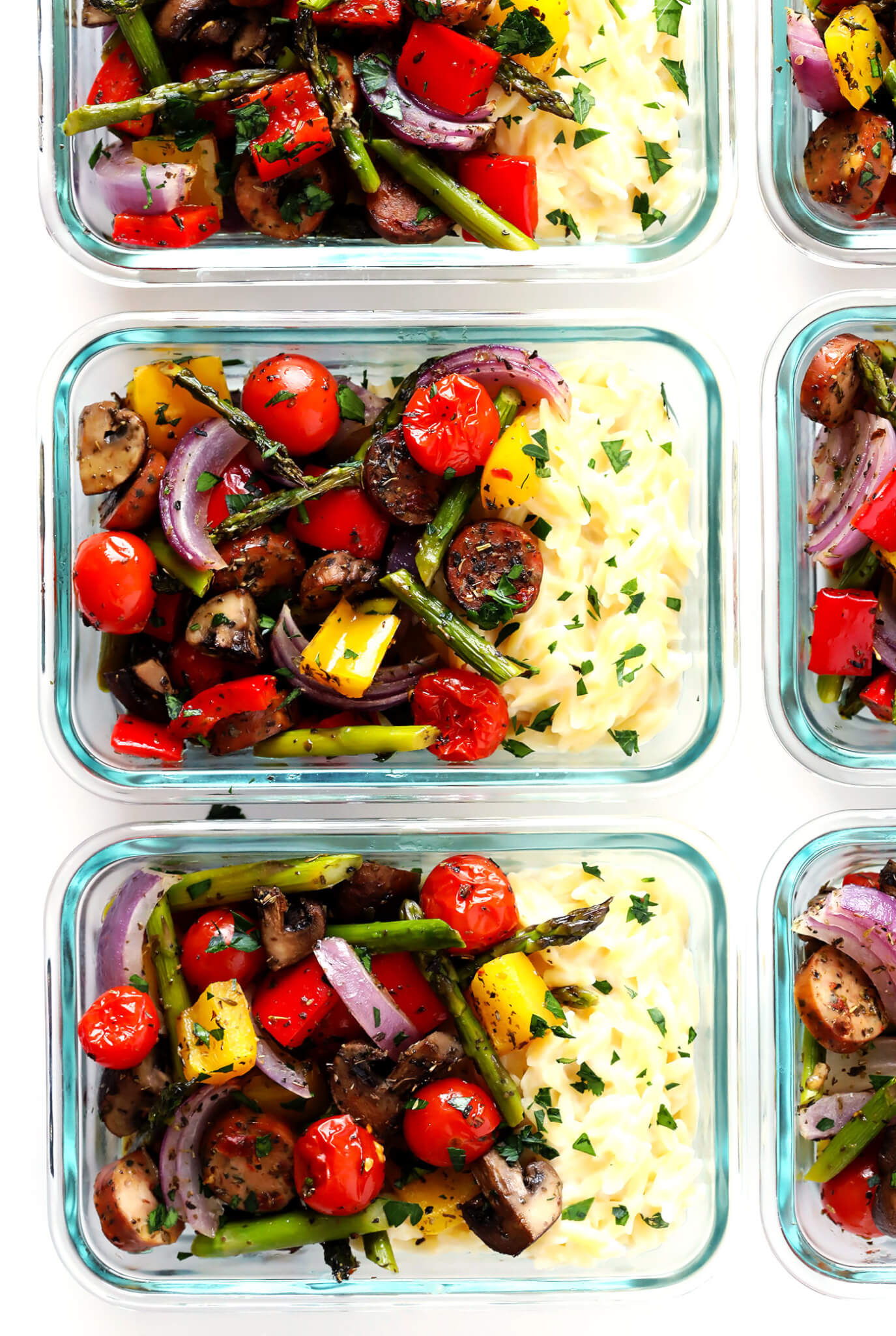 LOVE these Italian Sausage and Veggie Bowls! They're made with Italian roasted vegetables (such as tomatoes, asparagus, peppers, onions, mushrooms), paired with Parmesan Garlic Orzo Pasta, and perfect for easy lunch or dinner meal prep. So delicious! | gimmesomeoven.com