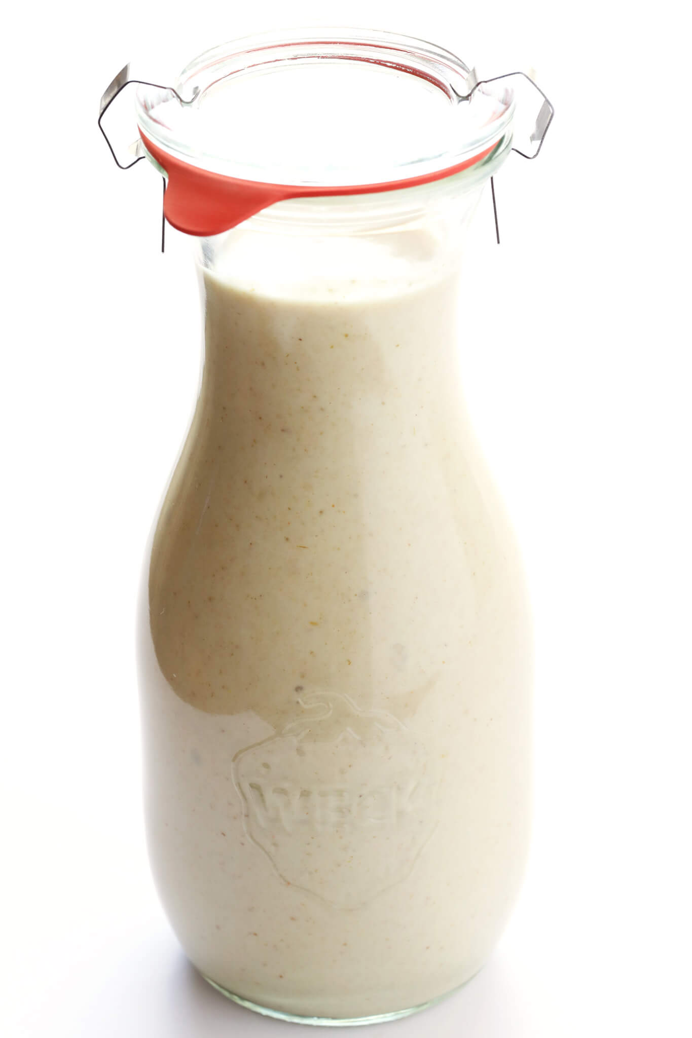 This Dreamy Tahini Dressing is the BEST! It's perfectly creamy and savory and delicious, especially with the zesty kick of lemon and garlic. Perfect drizzled on a salad or roasted vegetables or grilled chicken or more! | gimmesomeoven.com (Vegetarian / Gluten-Free)