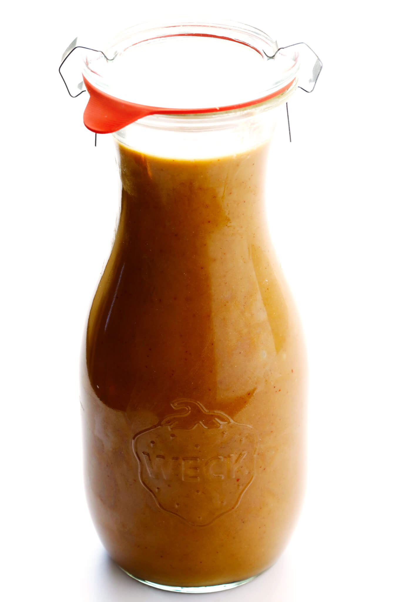 The BEST Thai Peanut Dressing!! It's the perfect blend of sweet and savory, with accents of ginger, lime juice, garlic, sriracha, and of course, lots of peanut butter. Perfect for a salad, stir-fry, noodles, or even used as a dipping sauce.   gimmesomeoven.com (Vegetarian / Gluten-Free)