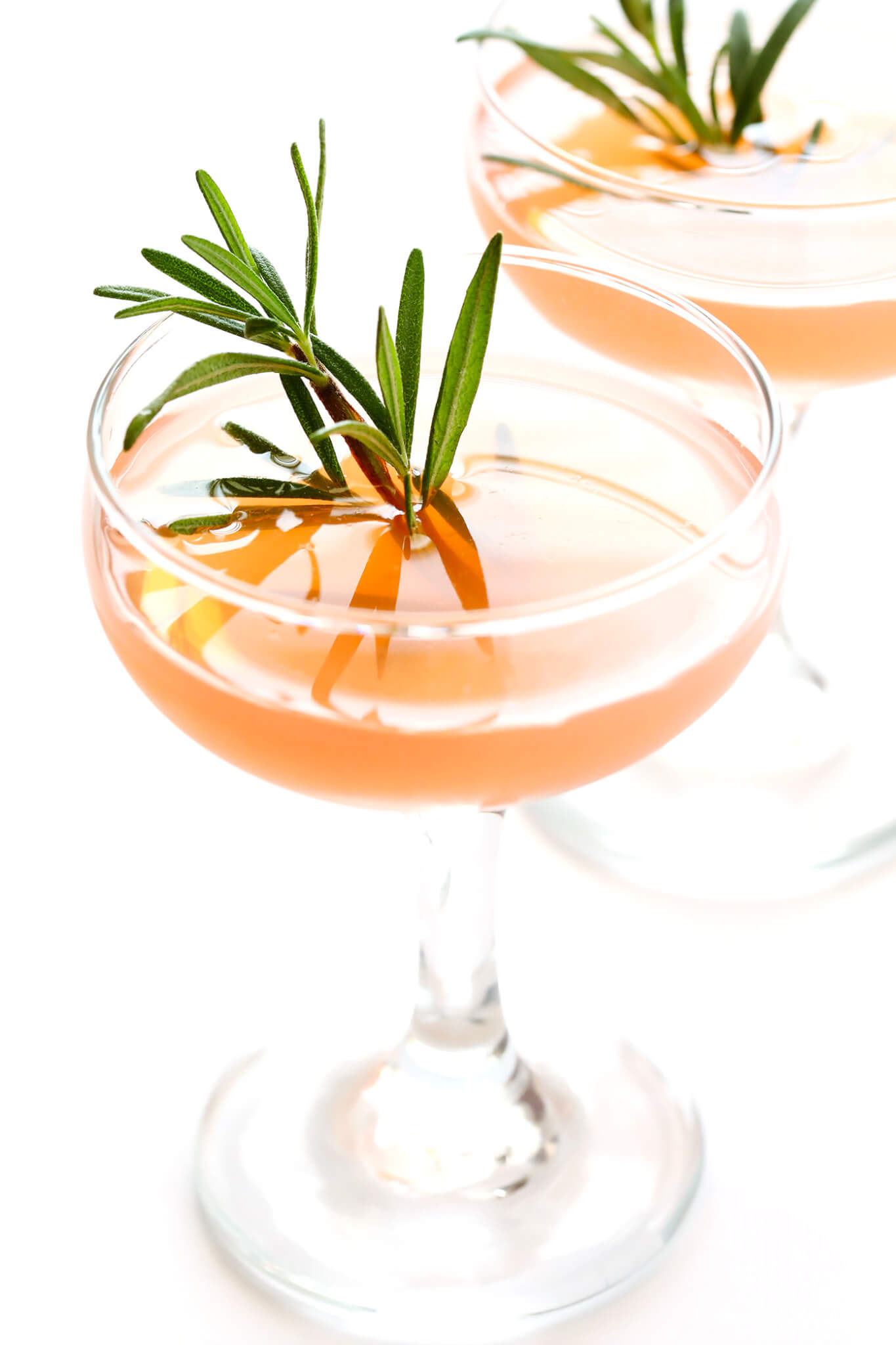 """These refreshing 30-second cocktails are quick and easy to make, they're made with gin (or vodka), St. Germain (elderflower liqueur) and grapefruit juice, and garnished with a sprig of fresh rosemary. They are classically known as the """"Frenchie"""" or """"Frenchy"""" cocktail -- so delicious!"""
