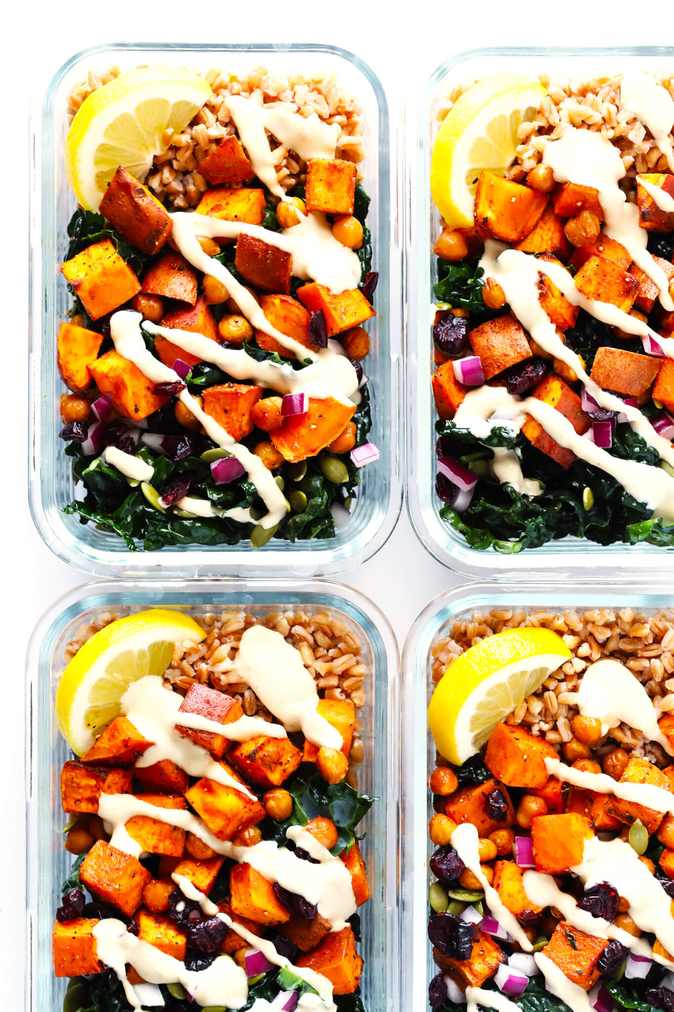 LOVE these meal prep kale salad bowls! They're filled with roasted sweet potatoes, zesty chickpeas, tender kale, pepitas (pumpkin seeds), cranberries, red onions, and a dreamy lemon-tahini dressing. Feel free to add quinoa or farro or rice if you'd like too!   Gluten-Free, Vegetarian, Vegan   Gimme Some Oven
