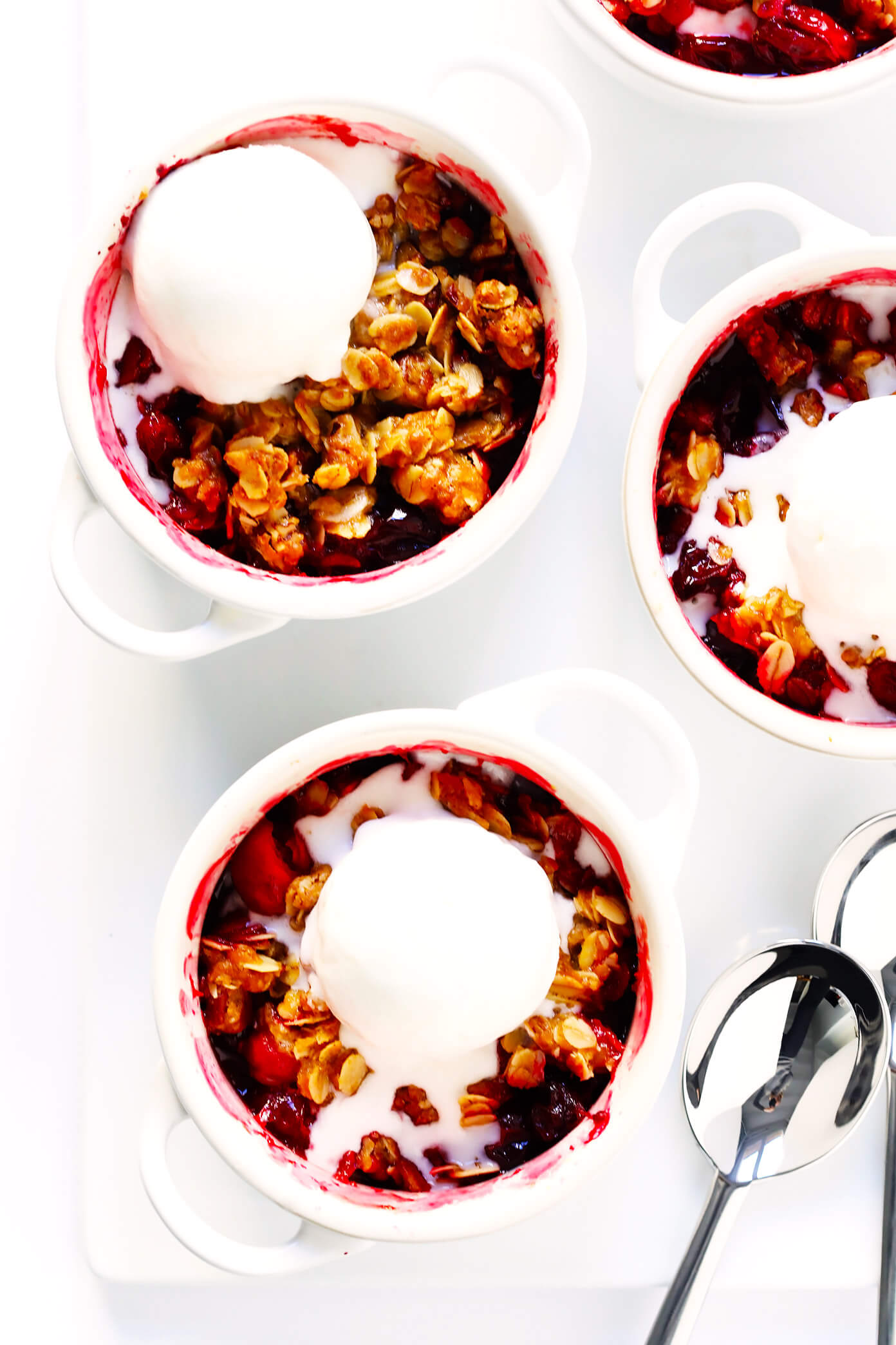 LOVE this easy Cranberry Crisp recipe! It's the perfect holiday dessert for Thanksgiving or Christmas, it's made with a crunchy butter pecan oatmeal topping, and it's the perfect use for your leftover fresh cranberries!