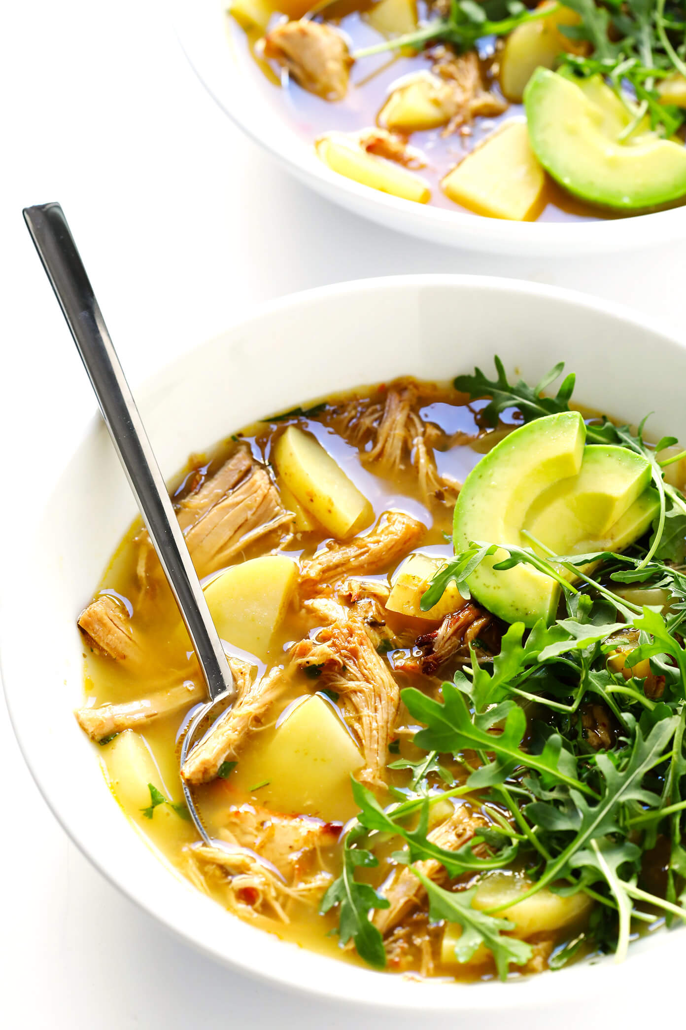 This 5-Ingredient Carnitas Soup is super-easy to make with leftover pork (or chicken) carnitas, potatoes, and salsa verde. I highly recommend loading it up with lots of toppings too, such as arugula, avocado, cilantro and jalapeño peppers. It's the perfect Mexican dinner that's easy to make on the stovetop, or in the Crock Pot (slow cooker) or Instant Pot (pressure cooker). And it's naturally gluten-free! | Gimme Some Oven