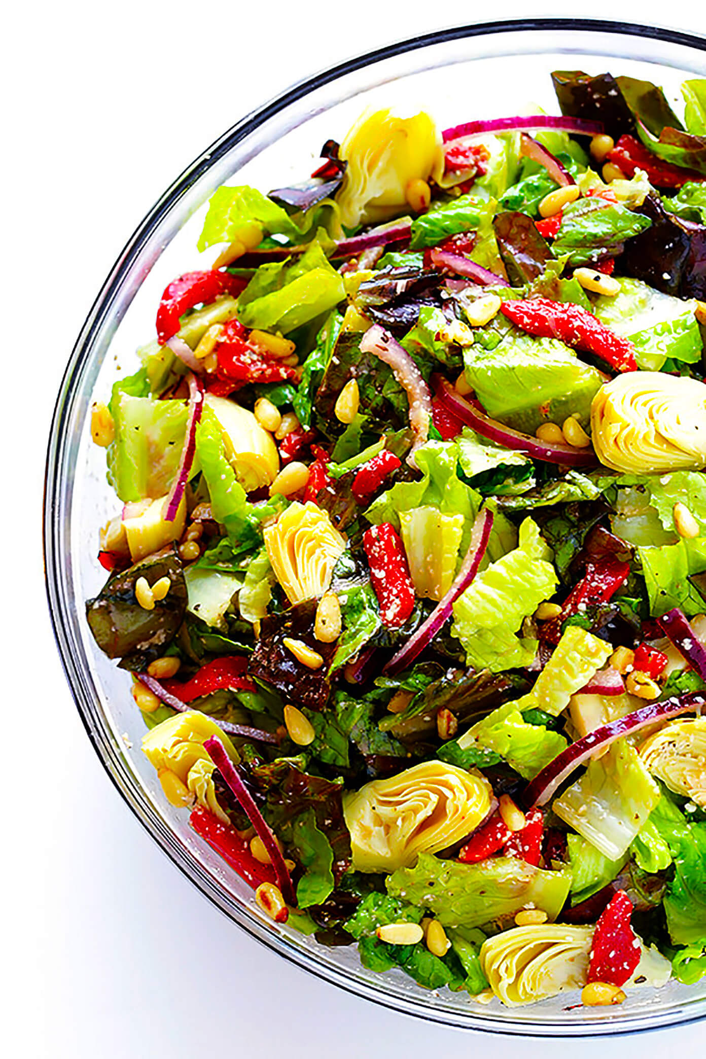 My family's favorite salad is always a crowd fave! It's made with lots of red leaf lettuce, artichokes, red onion, roasted red pepper, toasted pine nuts, and a delicious Italian-Parmesan vinaigrette.