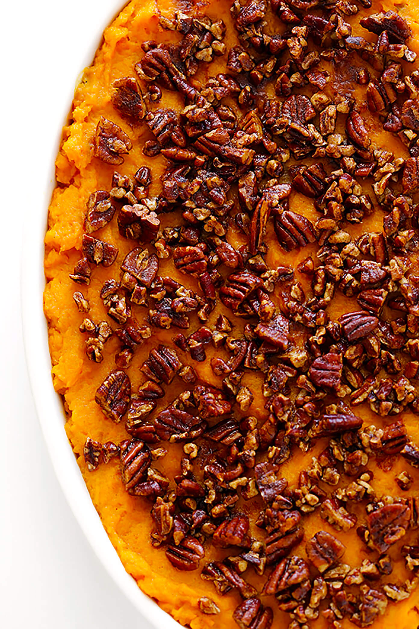 My favorite lightened-up Sweet Potato Casserole recipe! It's topped with delicious pecans, and perfect for Thanksgiving!